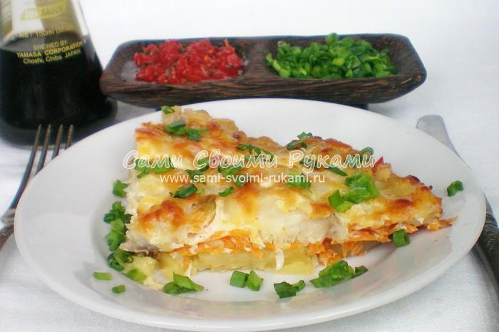 Минтай запеченный на овощной подушке в духовке