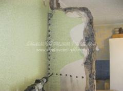 Высверливаем отверстия  в стене
